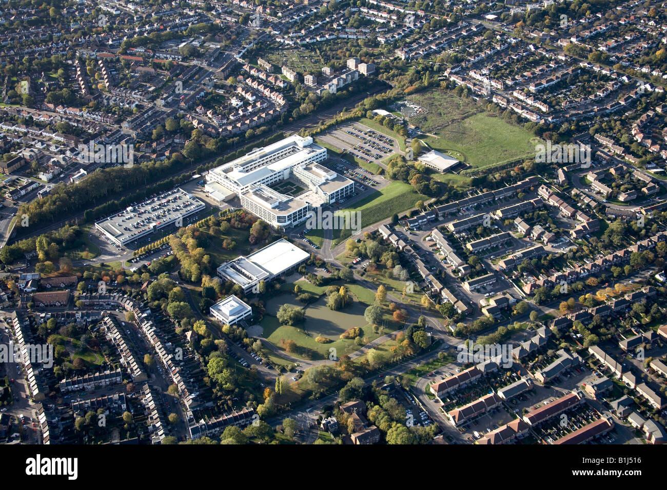 Aerial view west of suburban housing business centre sports ground and railway line Brunswick Park London N11 England - Stock Image