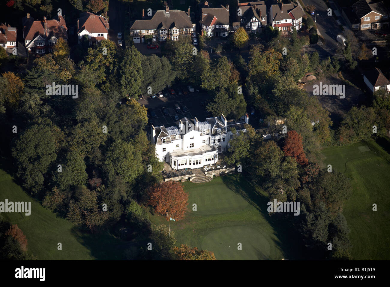 Aerial view north east of North Middlesex Golf Course Club House suburban houses Friern Barnet Lane Whetstone London - Stock Image