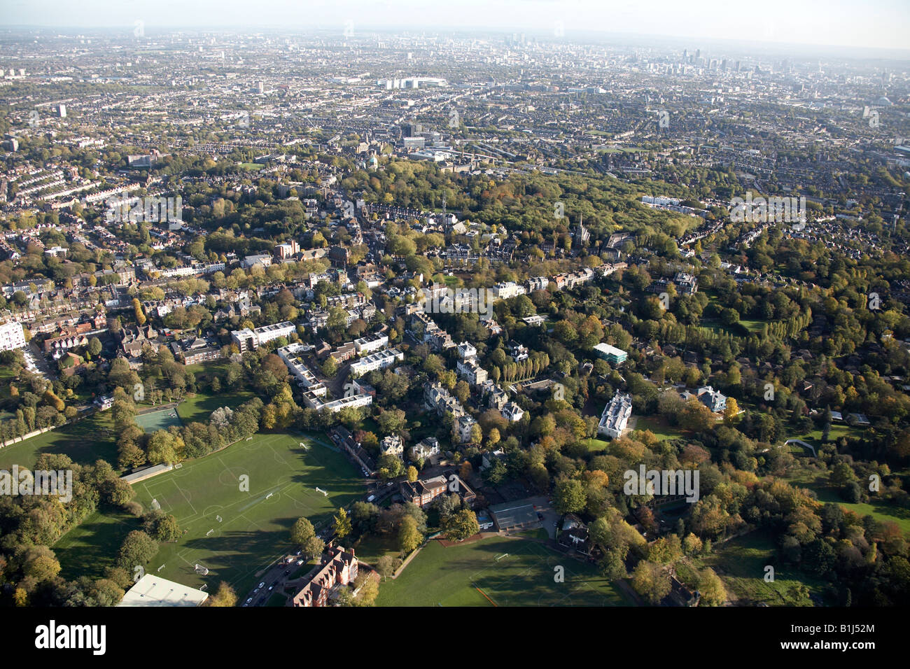 Aerial view south east of Highgate School and Sports Ground and suburban houses Highgate London N6 England UK - Stock Image