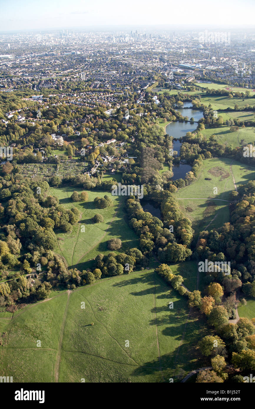 Aerial view south east of Ladies and Highgate Bathing Ponds Hampstead Heath allotment and suburban houses London - Stock Image