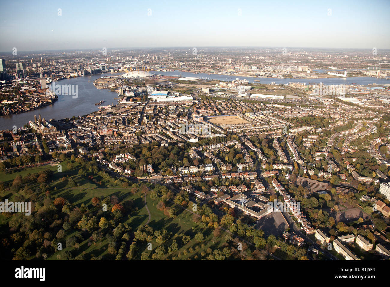 Aerial view north east of Greenwich Park suburban housing and industrial buildings Millennium Dome River Thames - Stock Image