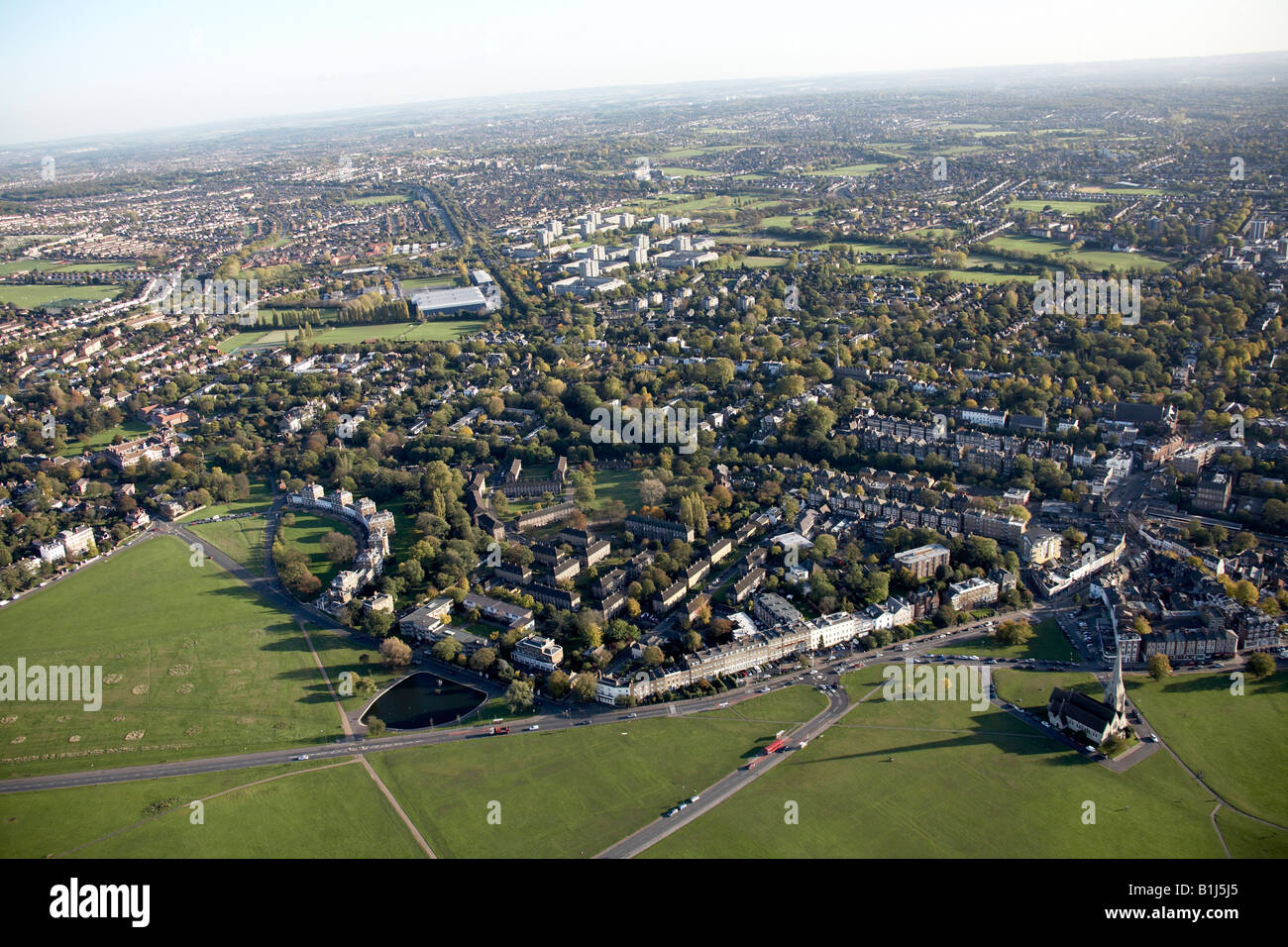 Aerial view south east of Black Heath suburban housing and All Saints Parish Church Blackheath Vale London SE3 England - Stock Image