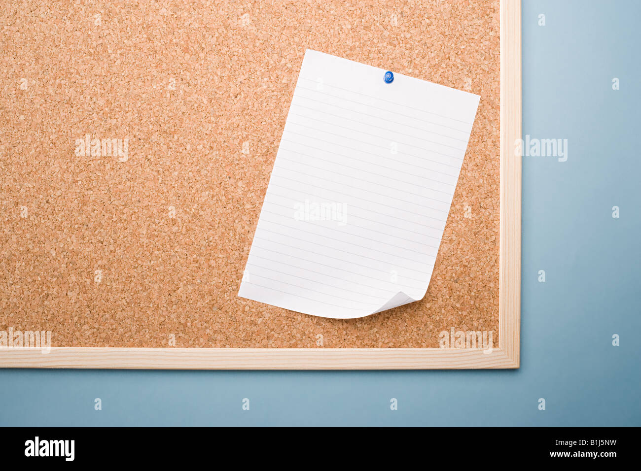 Paper on a noticeboard - Stock Image