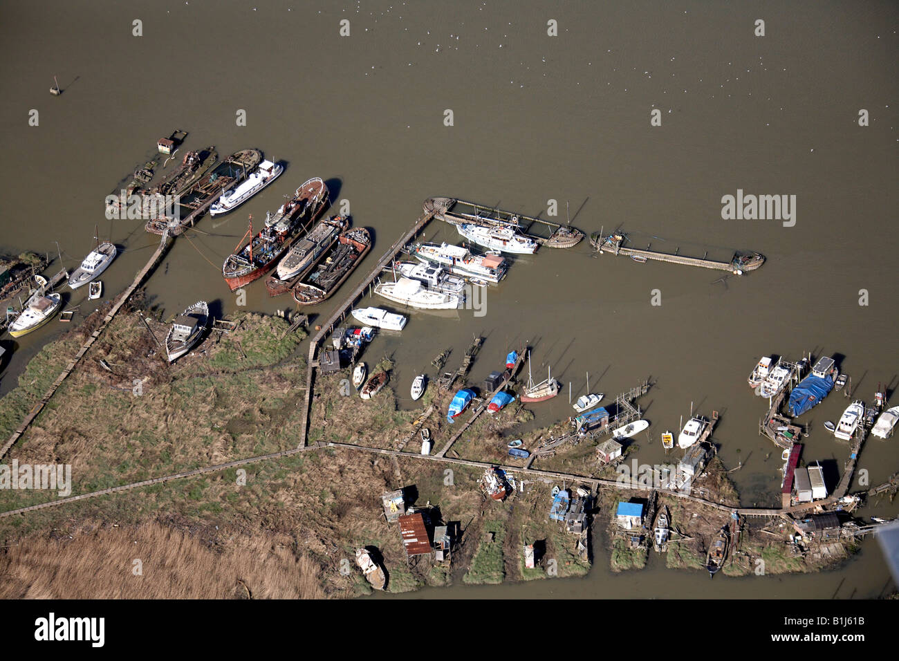 Aerial view north west of Fishing Boats Sailing Boats Merchant Ships The Saltings Erith Rands River Thames London Stock Photo