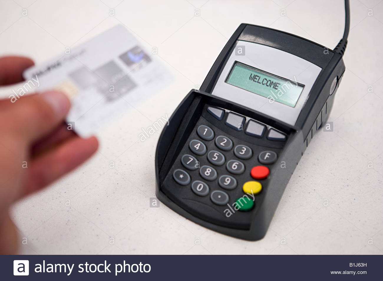 Person and credit card reader - Stock Image