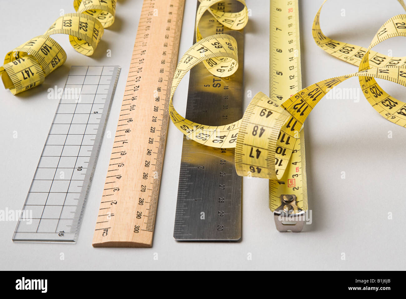 Rulers and tape measures - Stock Image