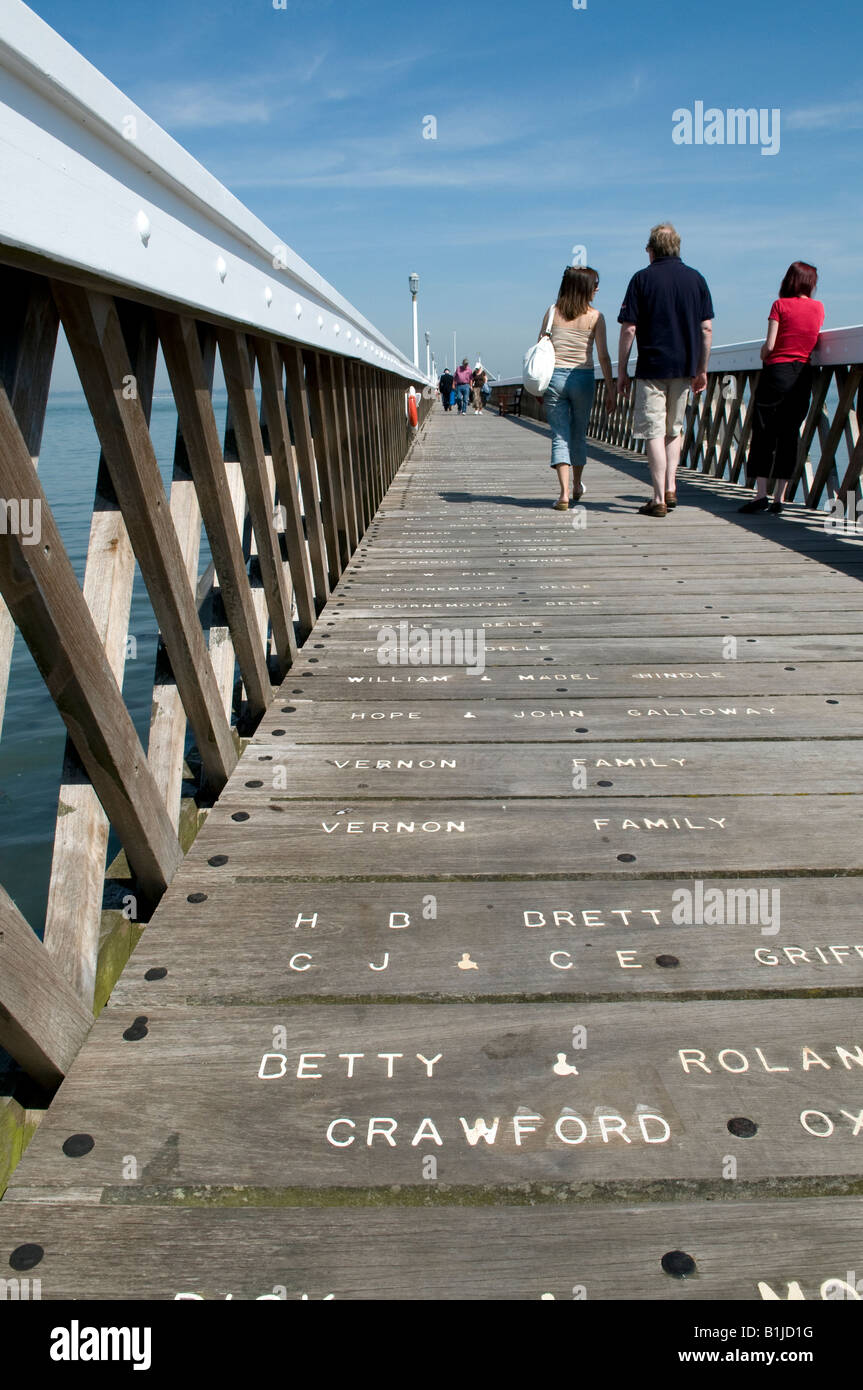 sea front pier Yarmouth Isle of Wight low floor angle showing names on board sponsors - Stock Image