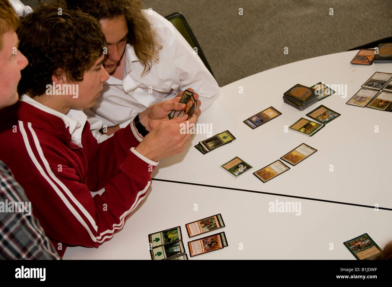 Two Teenage boys playing MAGIC THE GATHERING collectible card game - Stock Image