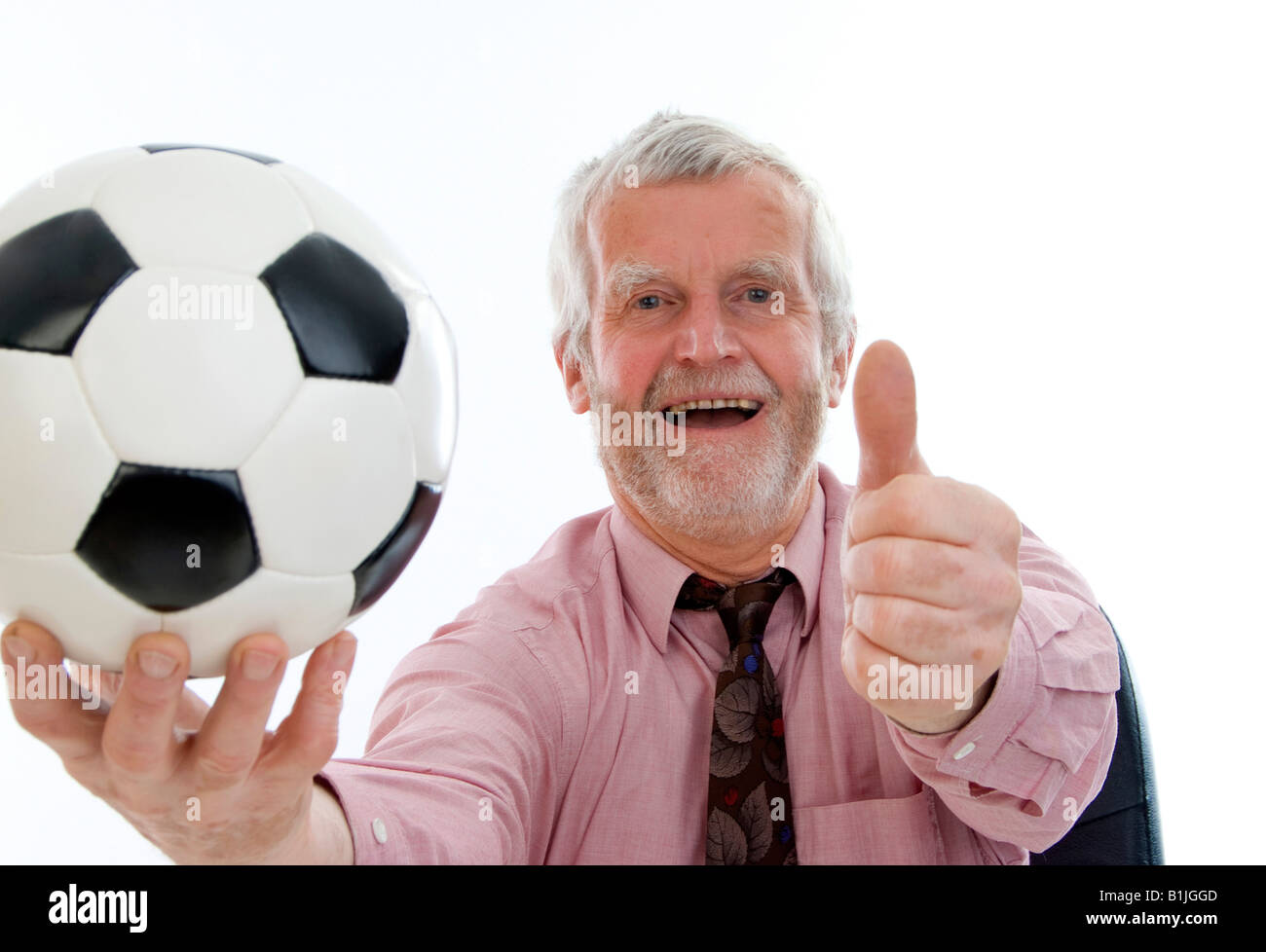 successful retiree with football - Stock Image