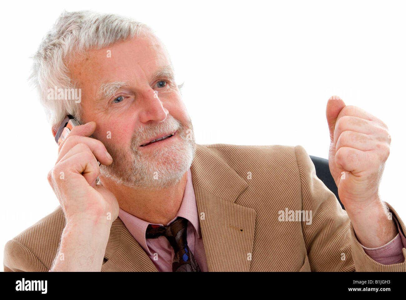 senior businessman with mobile phone - Stock Image