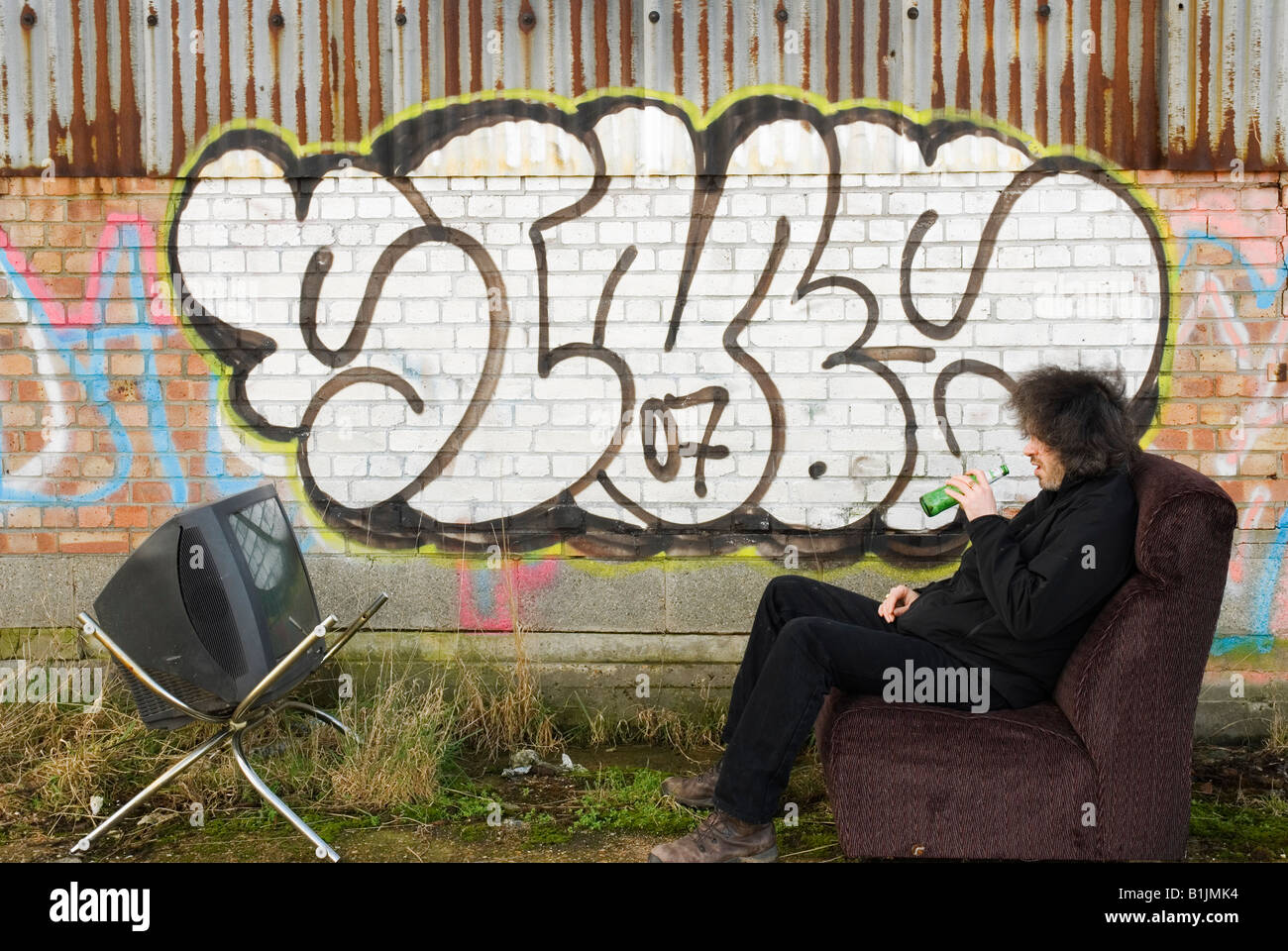 Watching the box in the great outdoors. - Stock Image