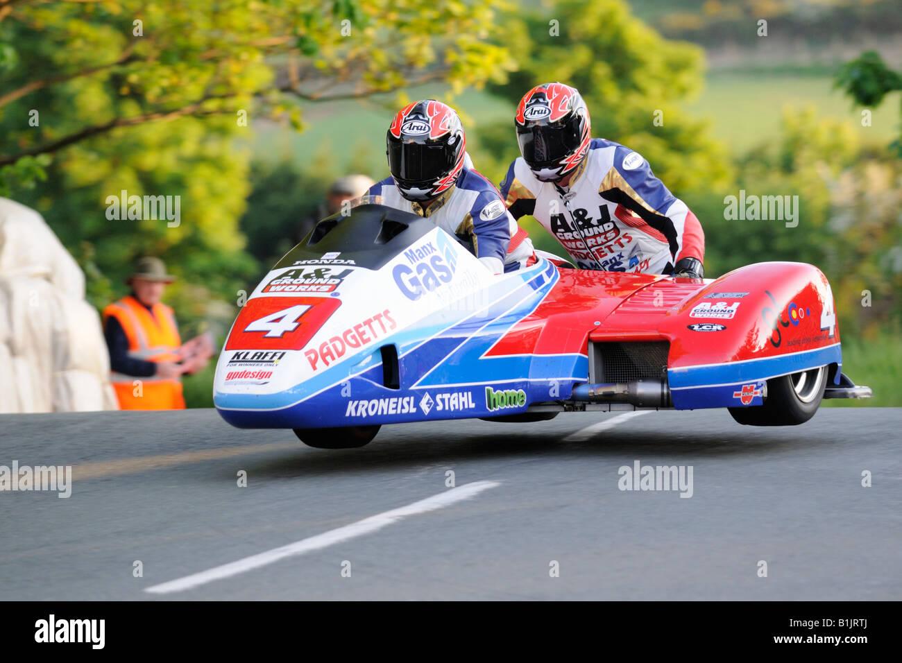 Klaus Klaffenbock and Christian Parzer leap Ballaugh bridge in their sidecar TT08. Stock Photo