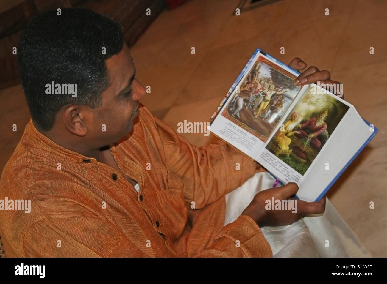 Hindu Man reading The Bhagavad Gita , A Hindu Holy book , India - Stock Image