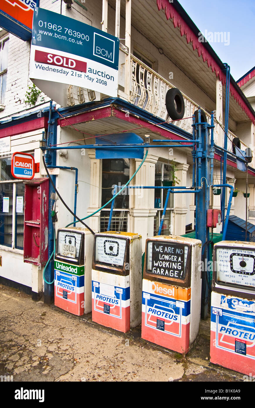 Defunct garage and petrol station sold at auction - Stock Image