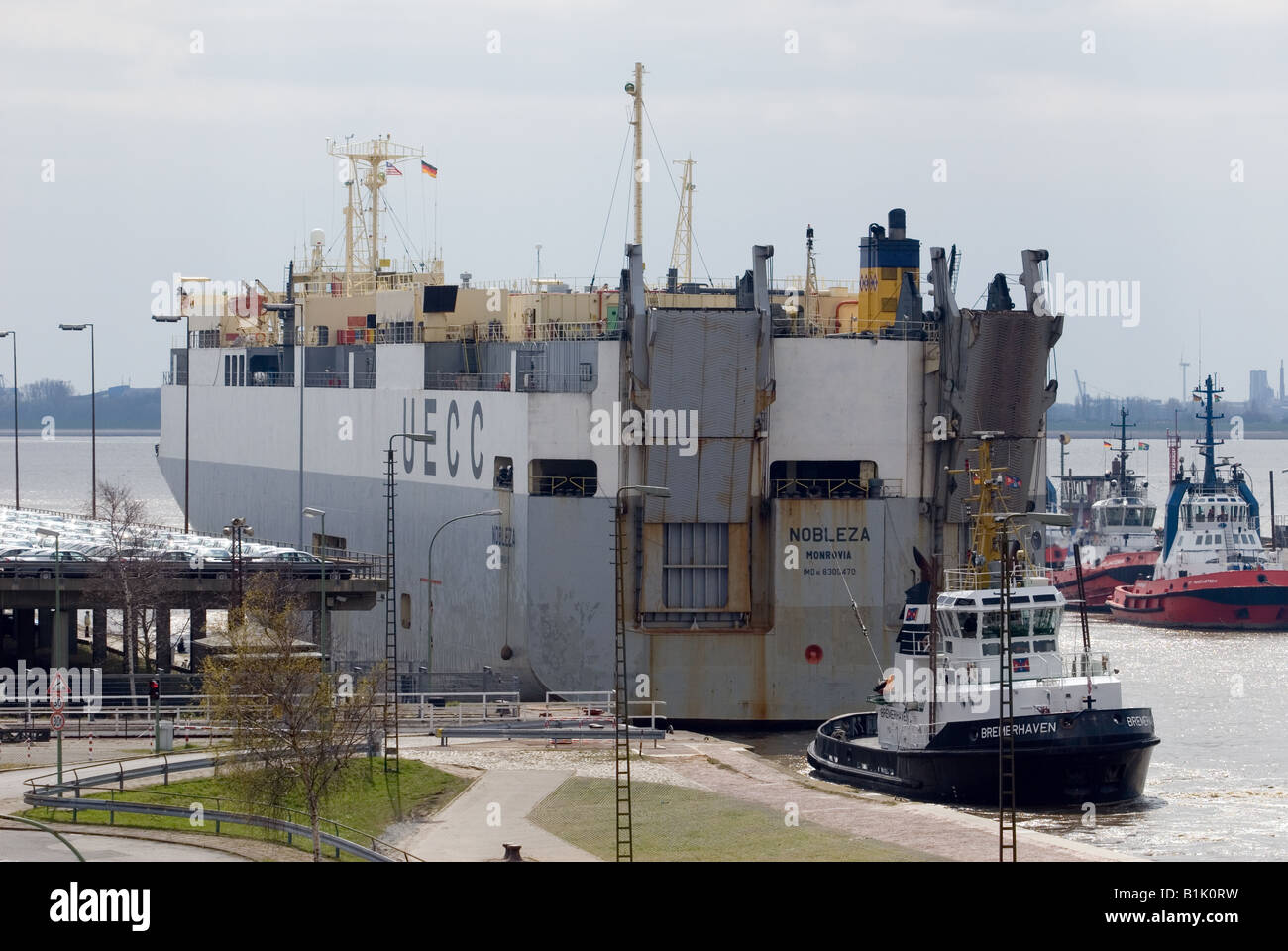 Car transporting ship at the port of Bremerhaven, Germany. - Stock Image