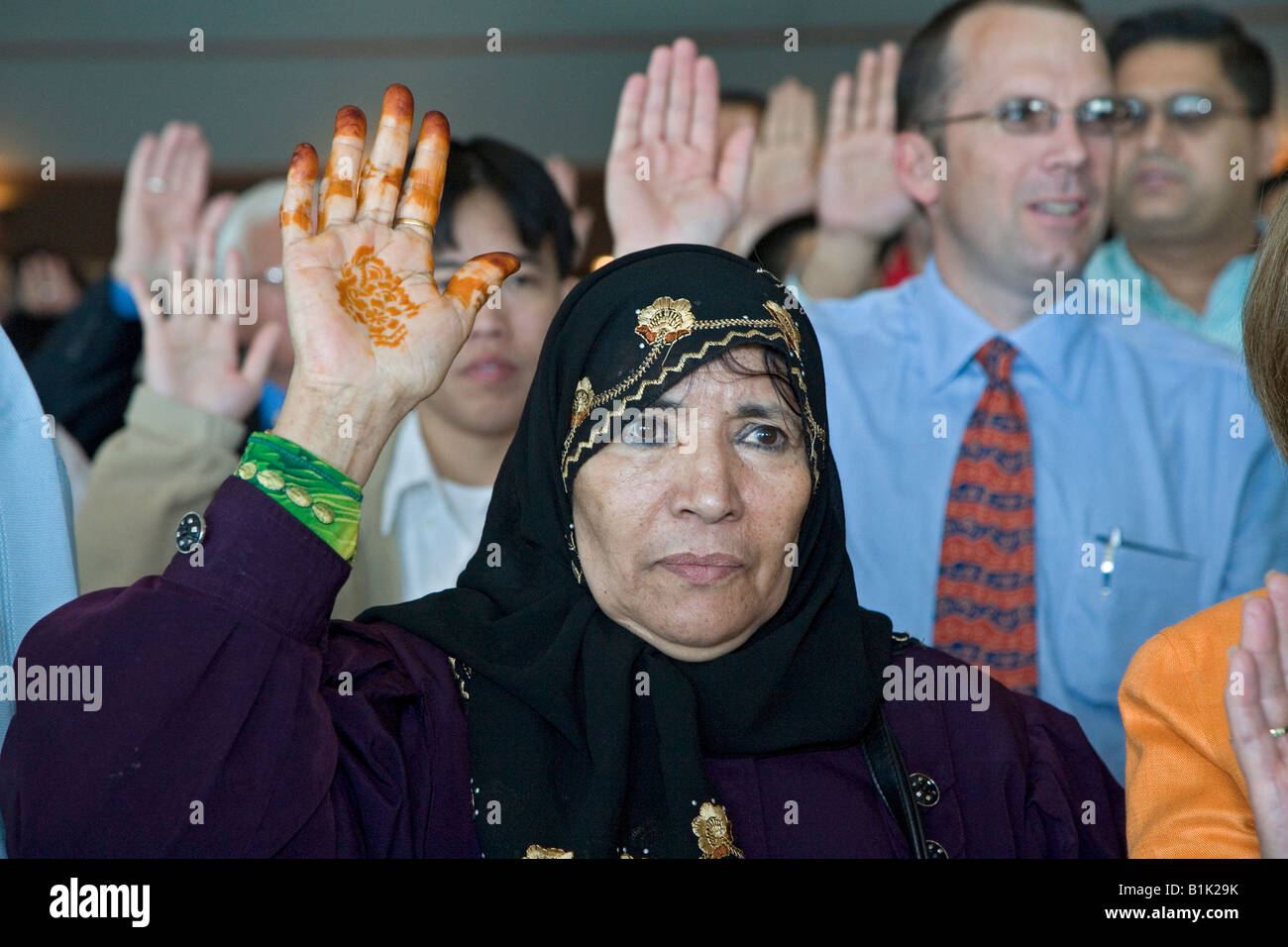 Detroit Michigan An woman from Yemen is one of 600 immigrants sworn in as new citizens of the United States - Stock Image