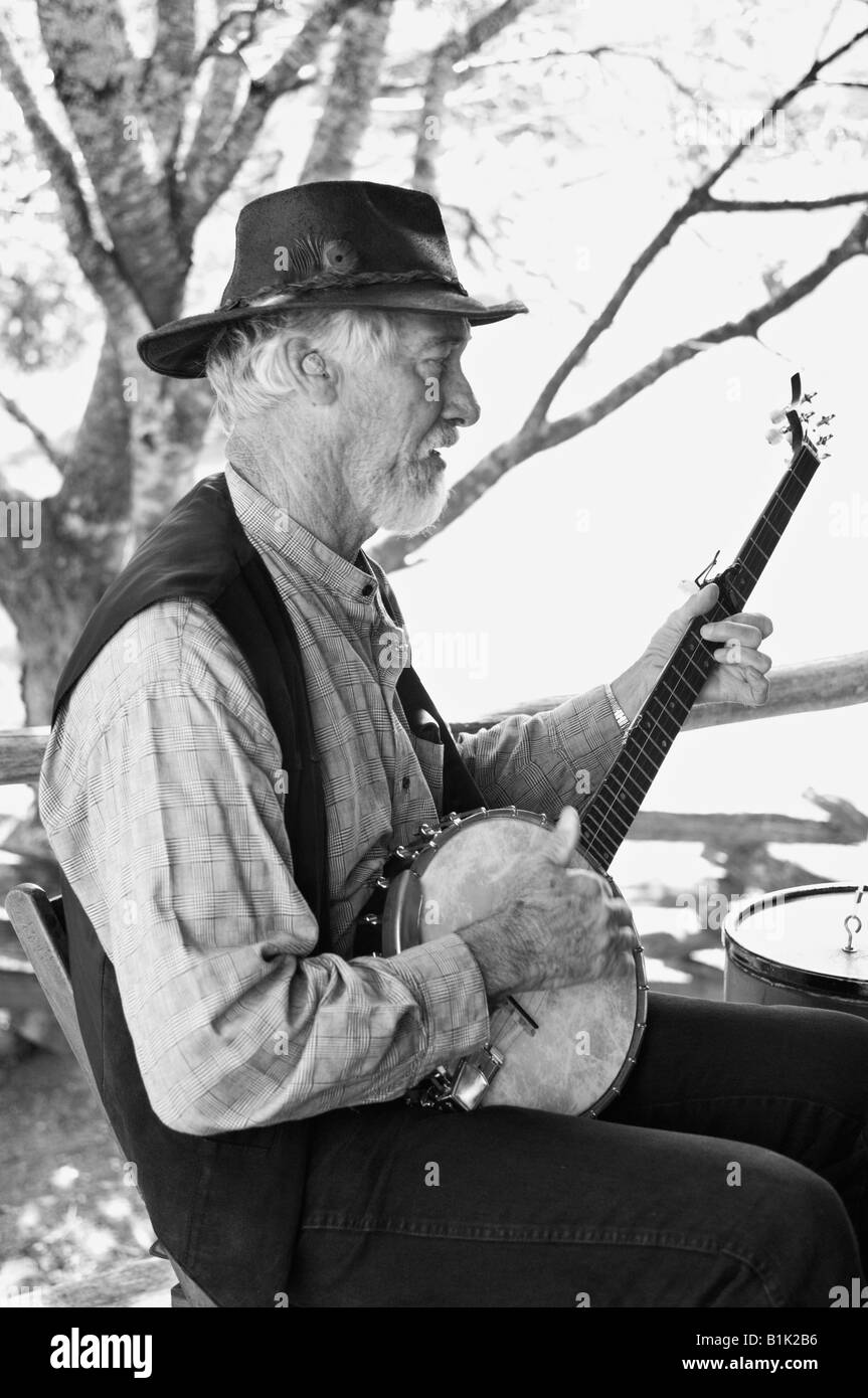 Old Time Country Musician Performing on Cabin Porch in Cades Cove Great Smoky Mountains National Park Tennessee - Stock Image