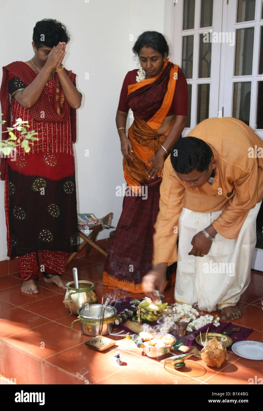 Hindu family prepare pongal pooja to the East of the house
