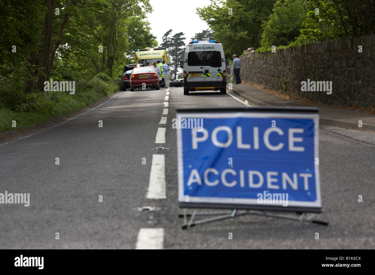 police accident temporary sign in the middle of the road at the scene of a road traffic accident county down northern Stock Photo