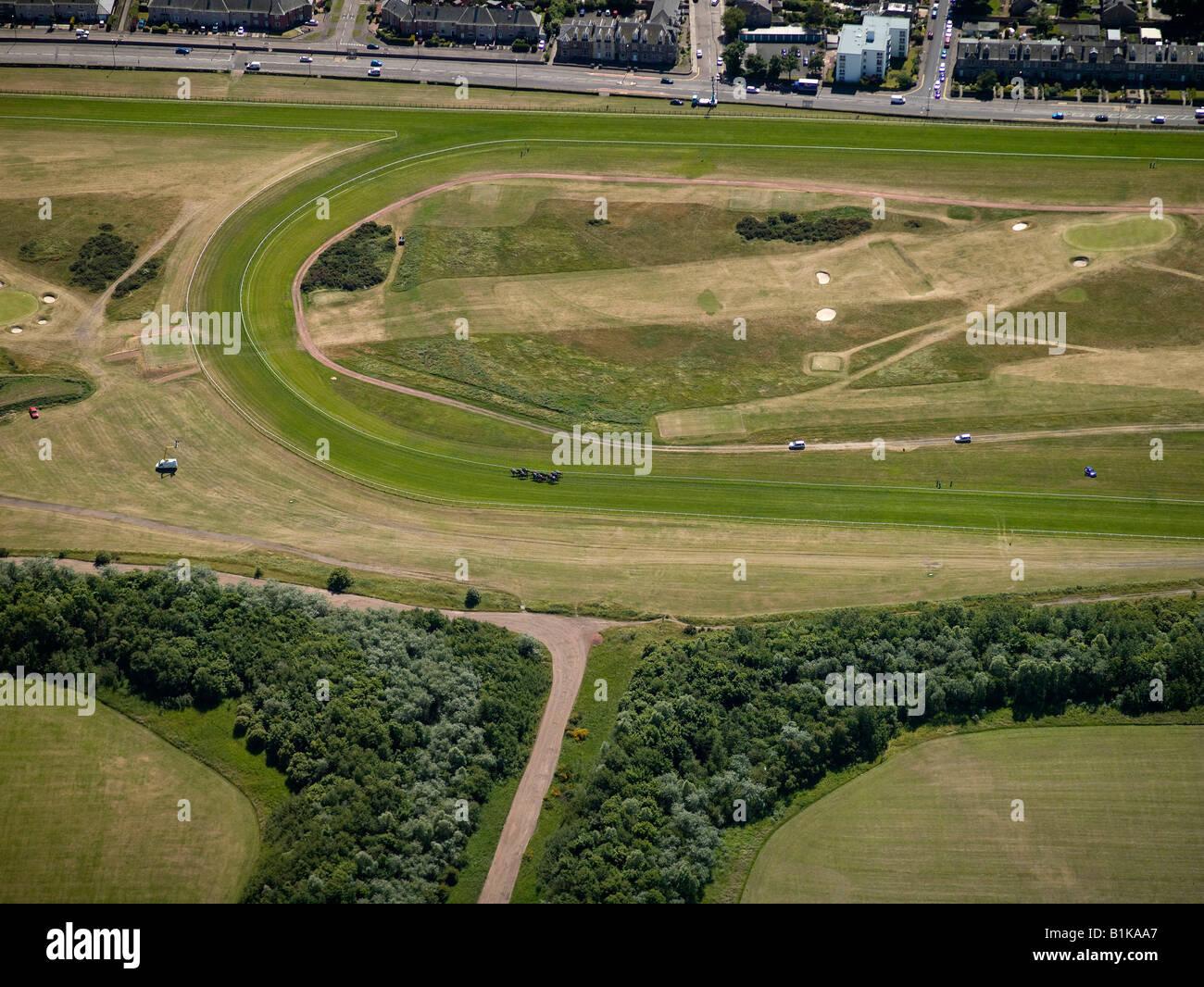 Horses racing at Musselburgh Race Course, Lothian, Scotland - Stock Image