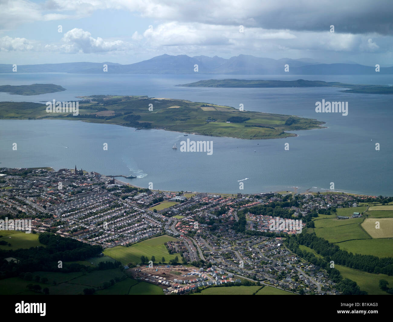 Largs and Little Cumbrae Island, in the Clyde Estuary, from the air, Western Scotland, Arran in the Distance. - Stock Image
