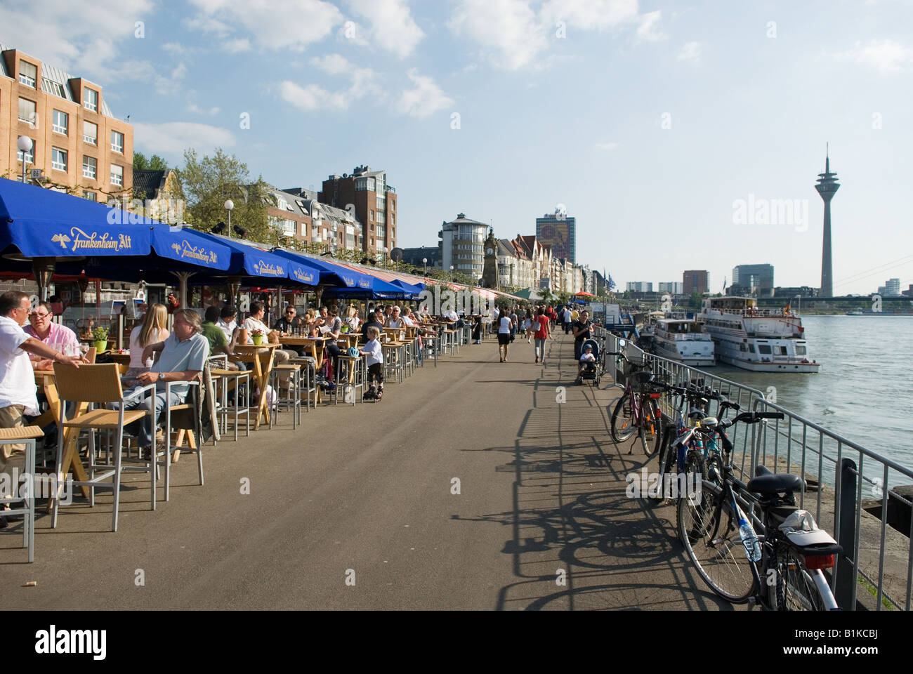 outdoor Pubs on the Riverside promenade of the Rhein River in Duesseldorf Germany - Stock Image