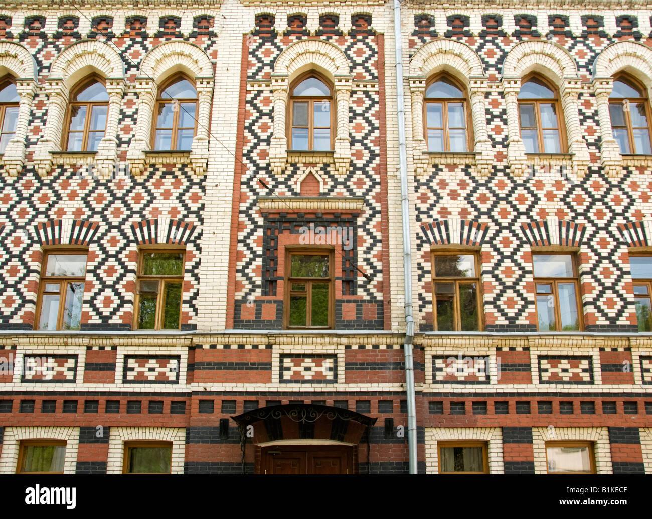 Patriarchal residence with ornate 19th century brickwork, near Sergei church, Krapivensky pereulok, Moscow, Russia - Stock Image