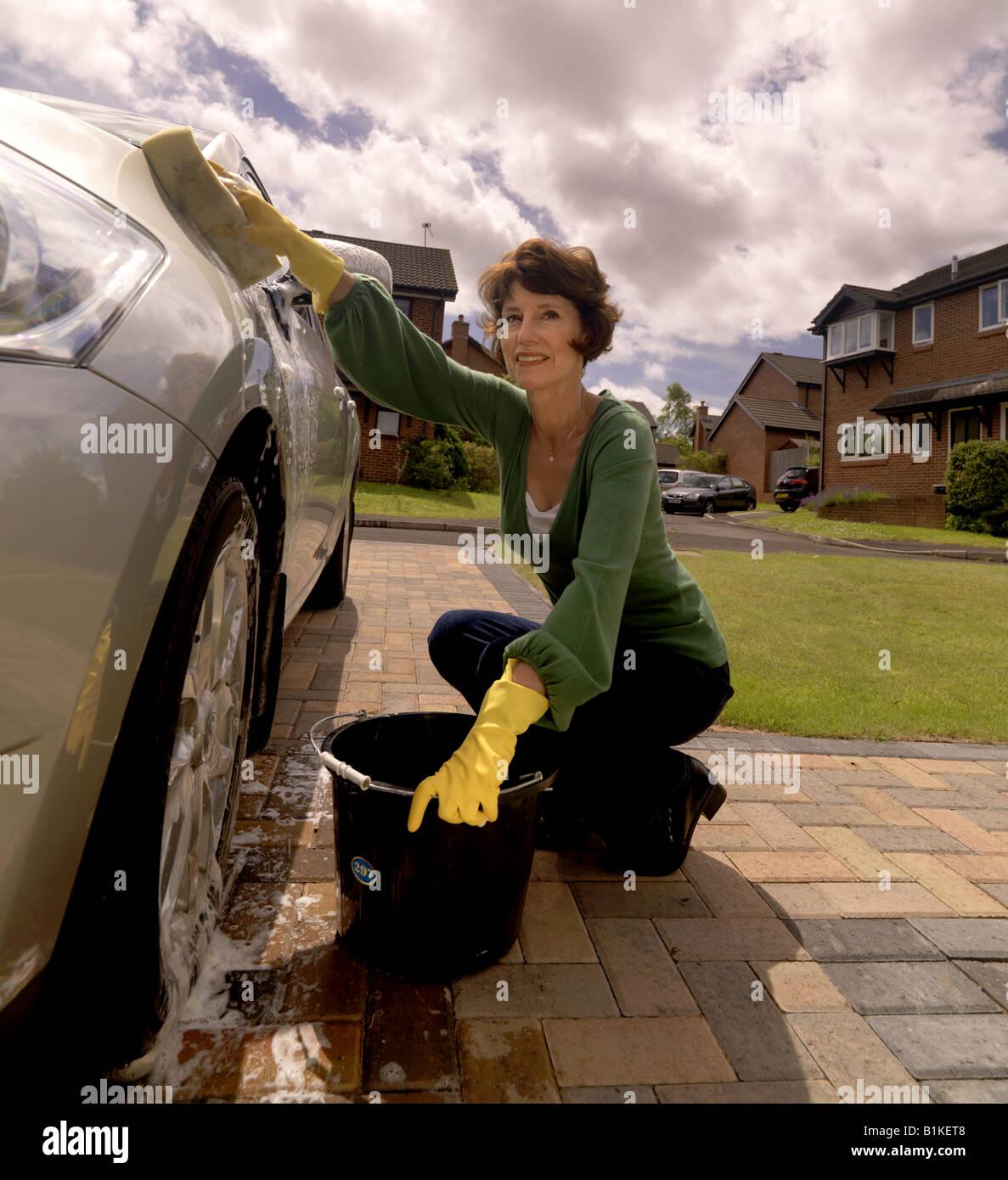 Car Stock Photos: Active Senior Woman Washing Car Stock Photo: 18253768