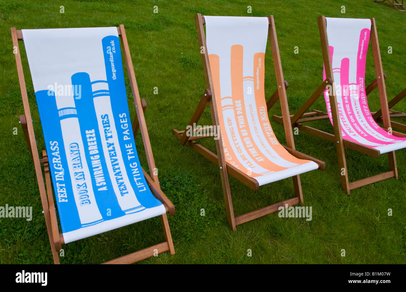 Promotional deckchairs on grass at The Guardian Hay Festival 2008 Hay on Wye Powys Wales UK EU - Stock Image