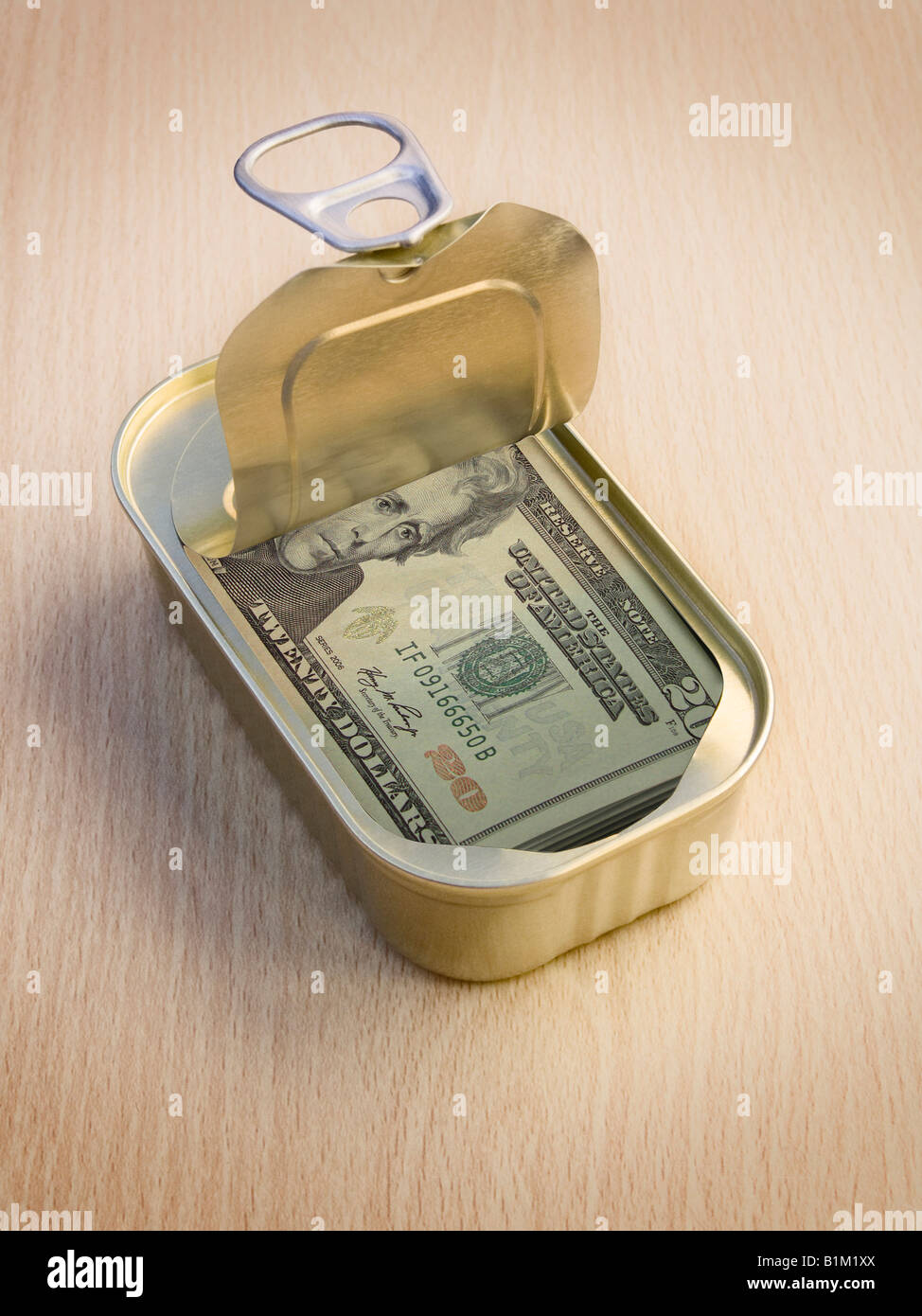 Ring Pull Tin containing  20 Dollar notes on wooden surface - Concept - Stock Image