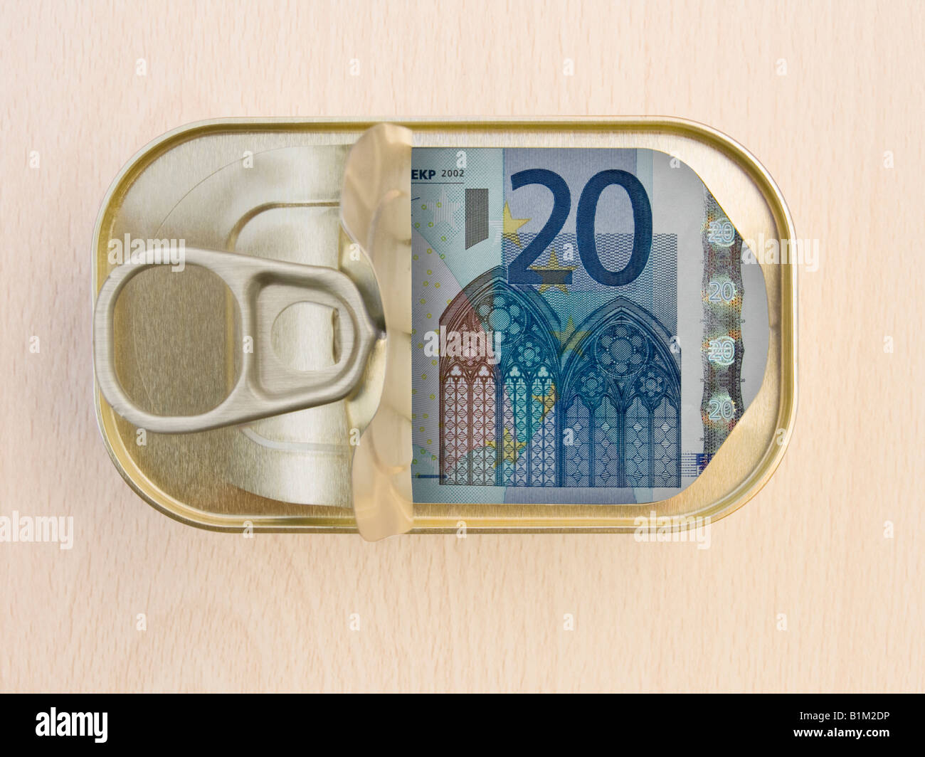 Plan view of a Ring Pull Tin containing 20 Euros on wooden surface - Stock Image
