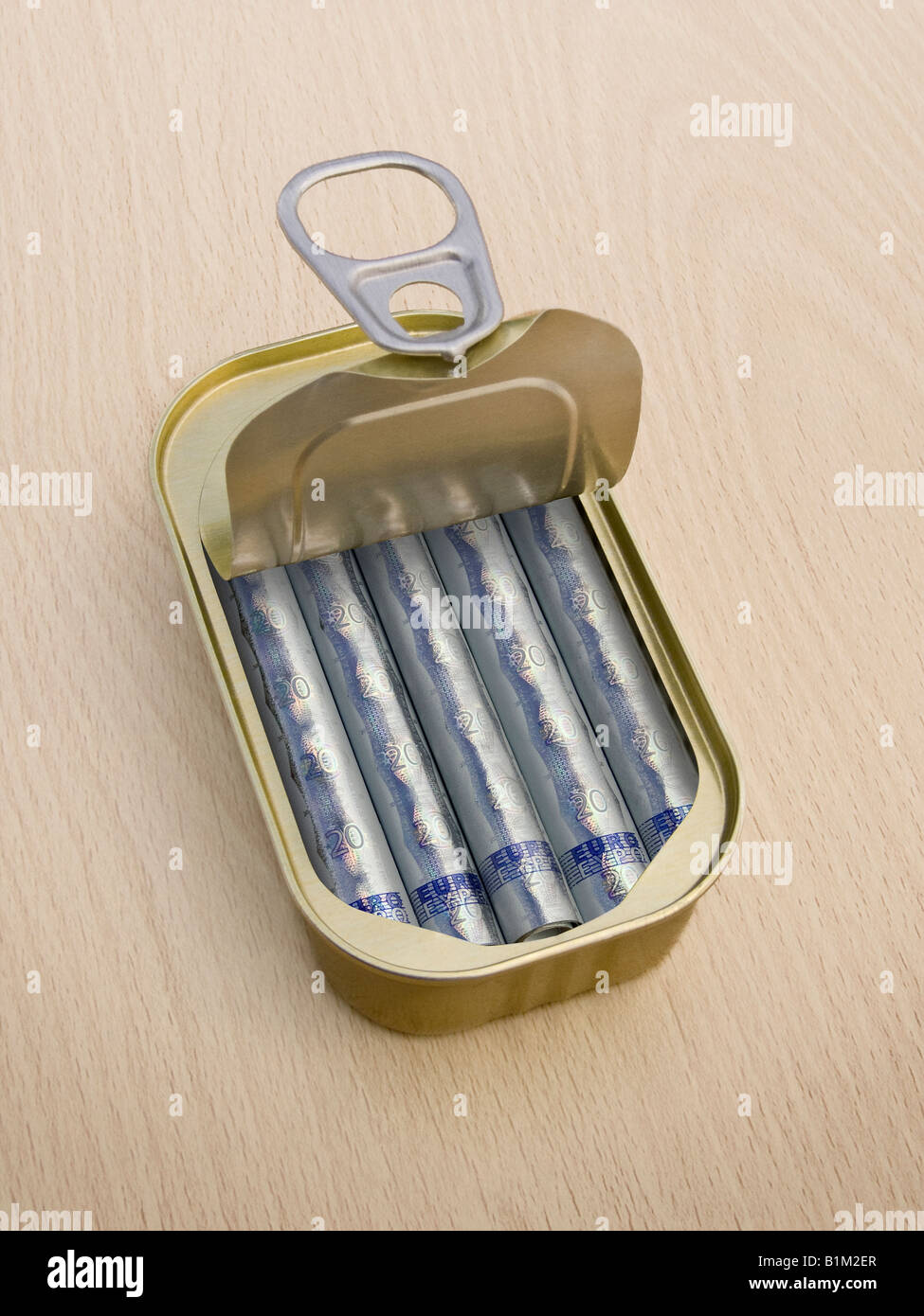 Ring Pull Tin containing rolled 20 Euro notes on wooden surface - Concept - Stock Image