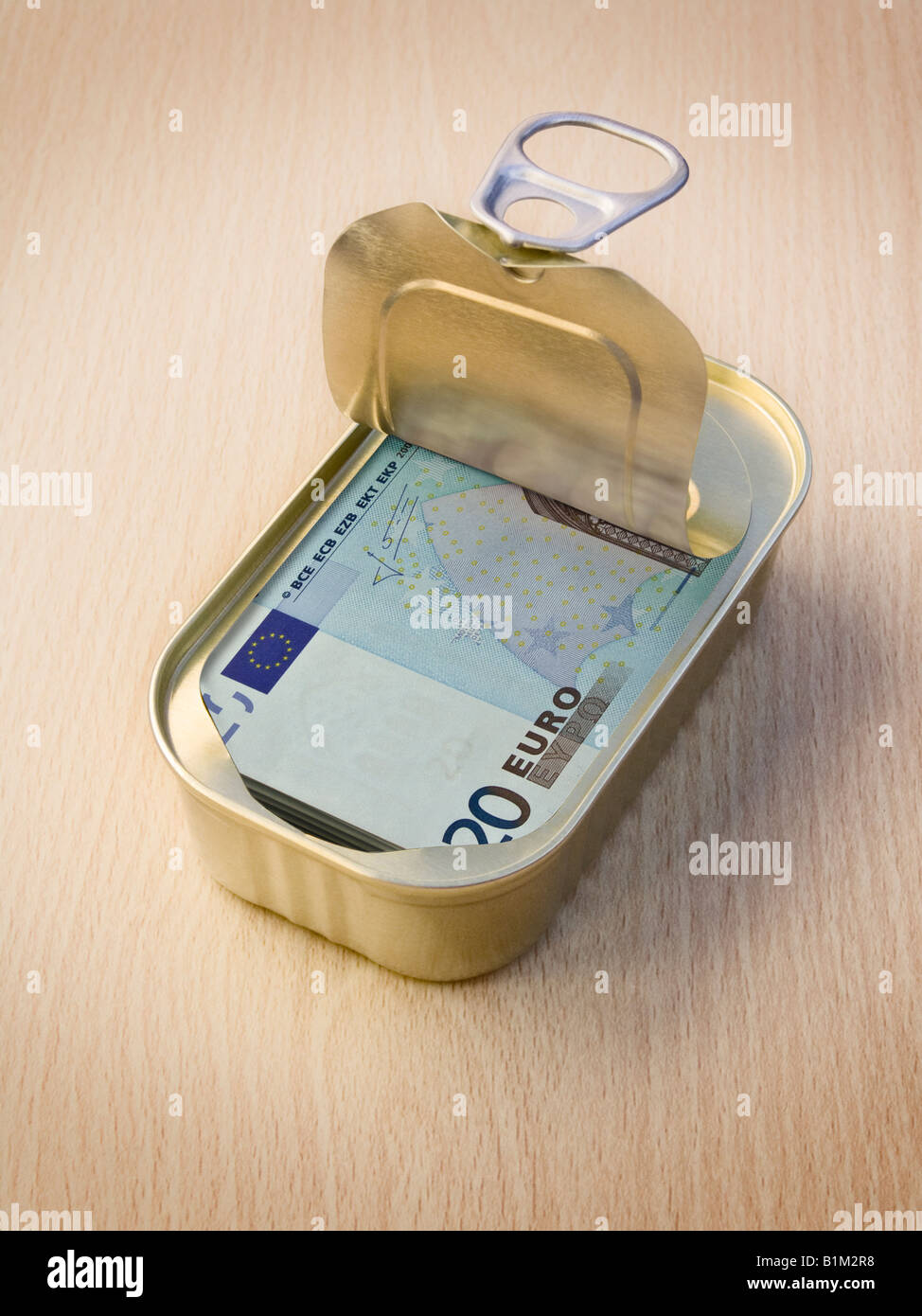 Ring Pull Tin containing 20 Euro notes on wooden surface - Concept Stock Photo