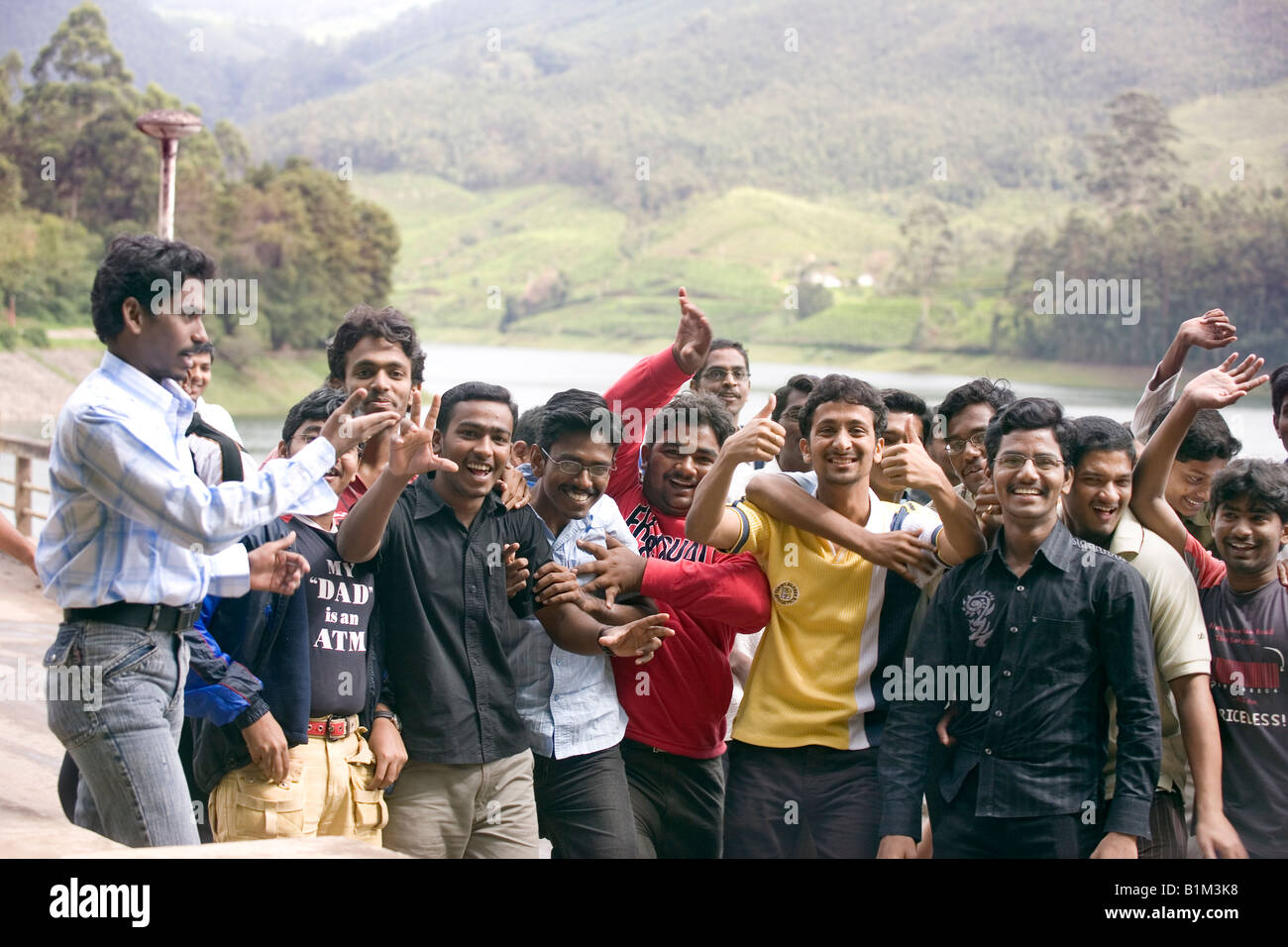 Young Indian men on  excursion pose in high spirits for the camera Mathupetty dam and lake area Idukki Kerala India - Stock Image