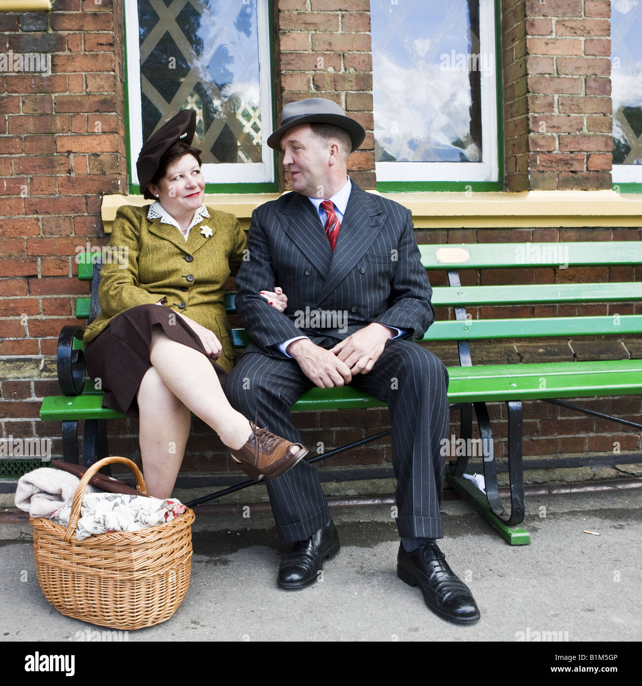 a584f3f282f Couple 1940s Waiting On Railway Platform with Bomb Taped Windows - Stock  Image