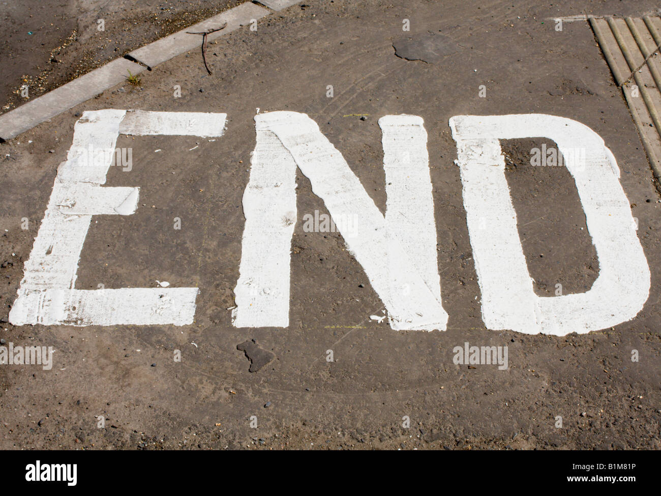 End printed on a pavement Stock Photo