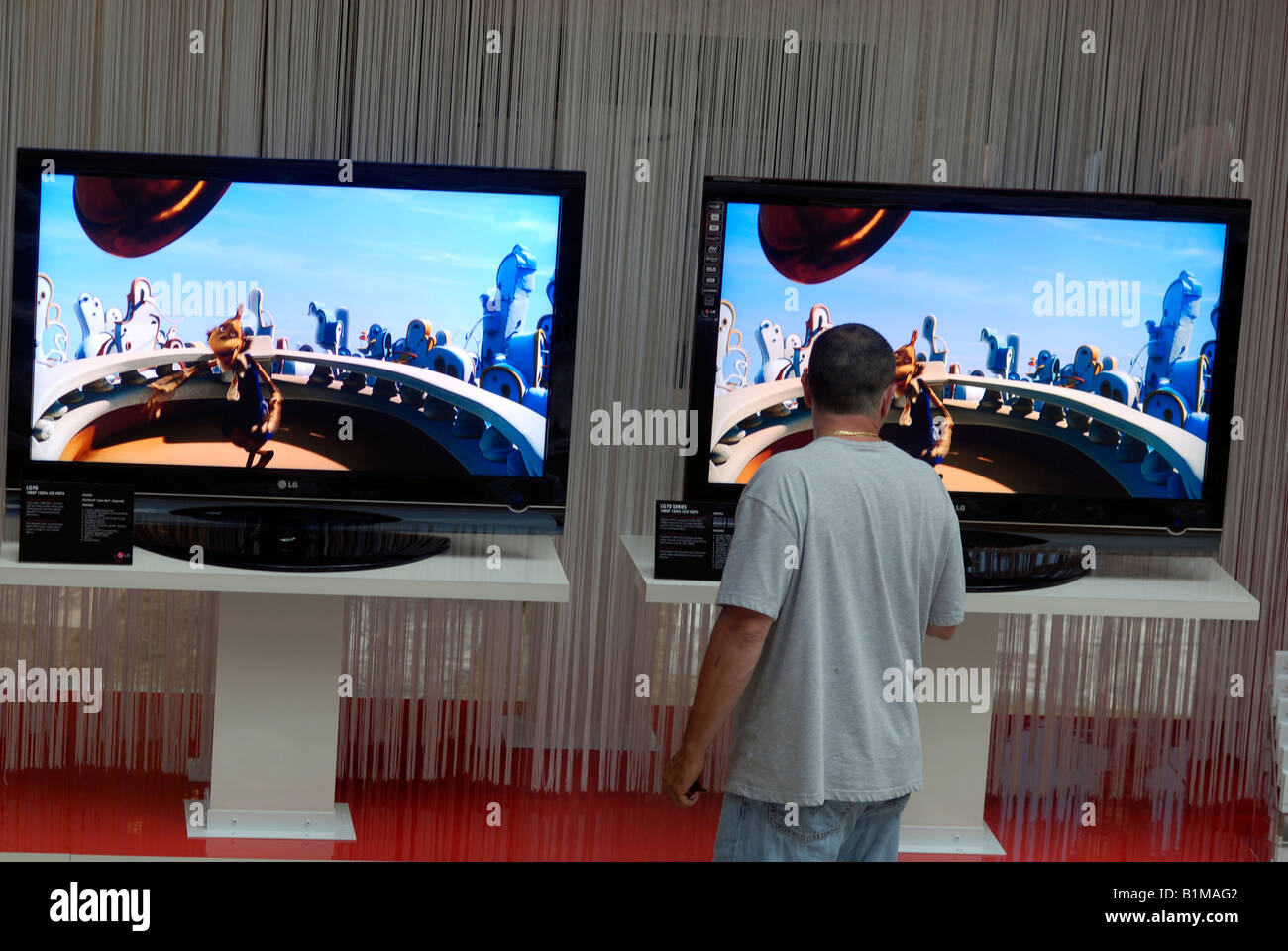 A consumer browses the LG Scarlet high definition televisions in the World Financial Center in New York - Stock Image