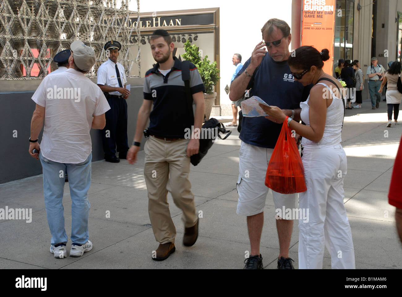 Map Of New York Rockefeller Center.Tourists Consult A Map In Front Of Rockefeller Center On Fifth