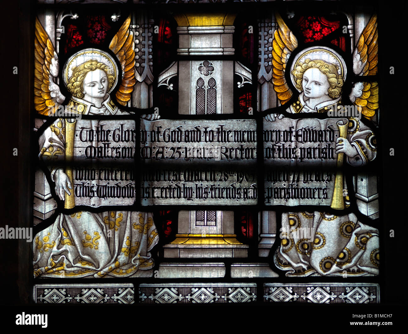 Stained Glass Window of Two Angels Holding a Memorial to a Past Rector Saint Nicholas Church Great Bookham Surrey - Stock Image
