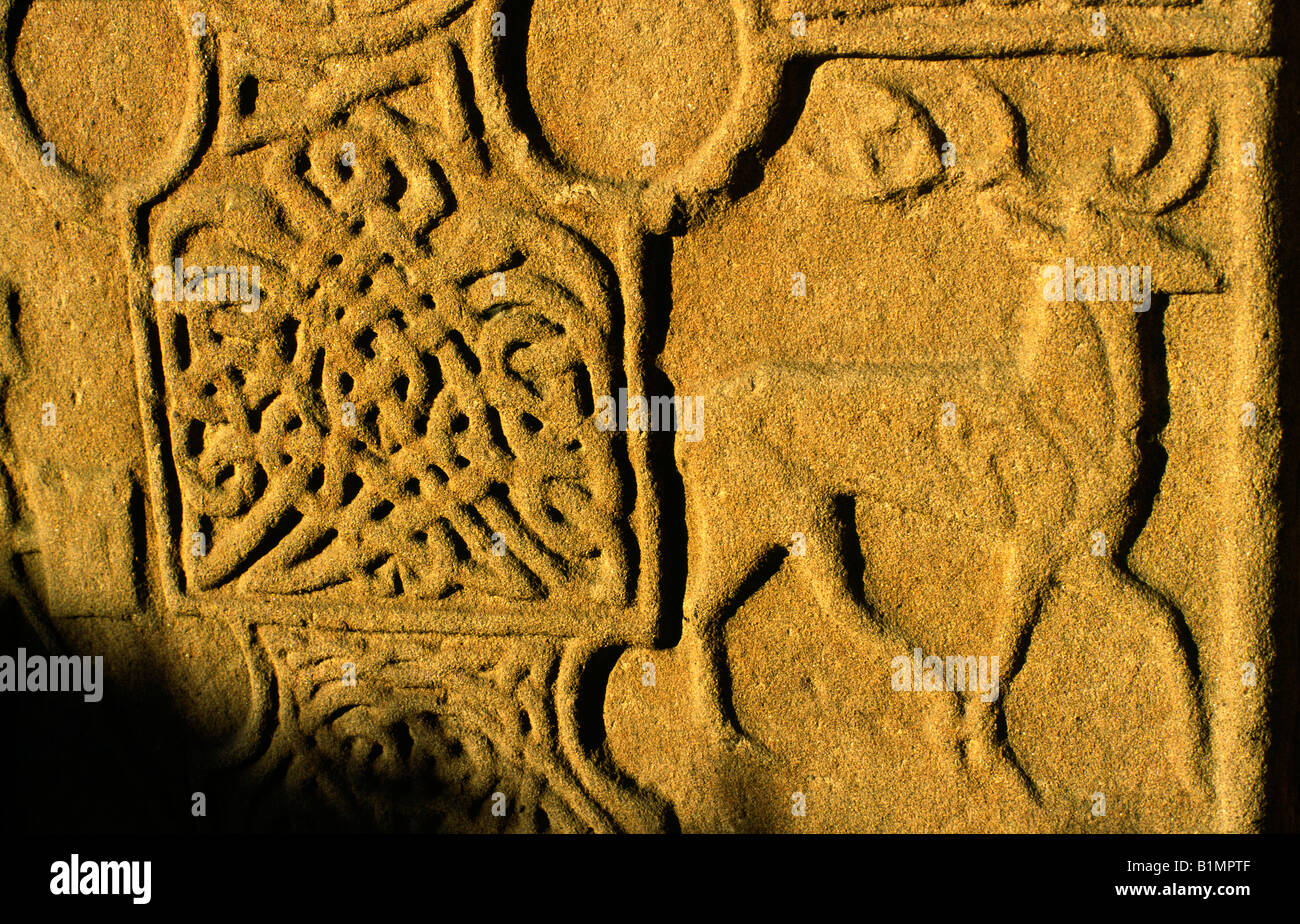Detail of Eassie carved stone Celtic Pictish Christian cross slab near Coupar Angus, Tayside, Scotland. Knotwork - Stock Image