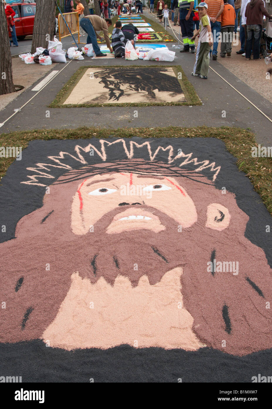 Residents of Tacaronte on Tenerife decorating the streets with Las Alfombras (carpets) de Corpus Christi using crushed - Stock Image