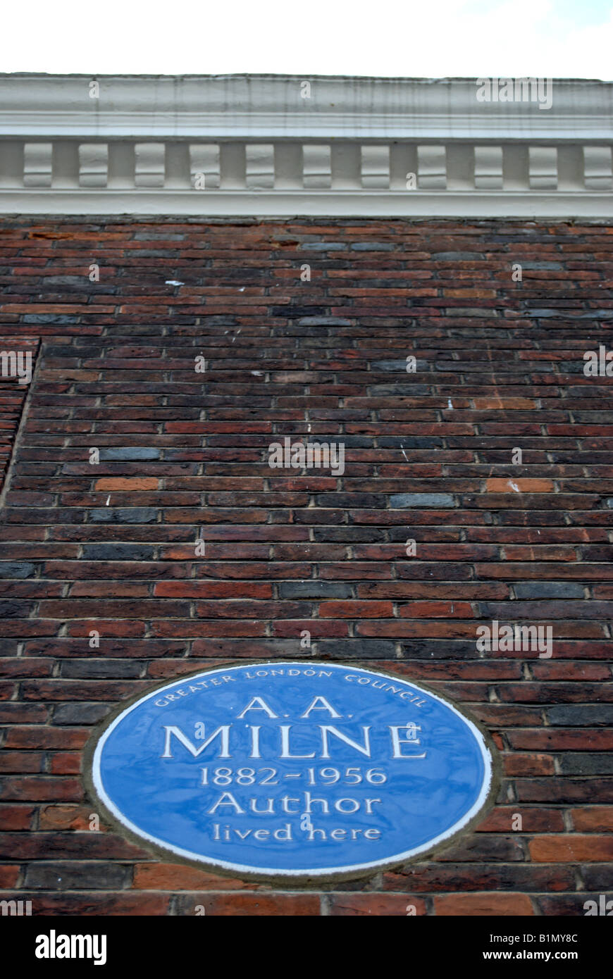 blue plaque marking a former home of english writer aa milne, creator of winnie the pooh, in mallord street, chelsea, - Stock Image