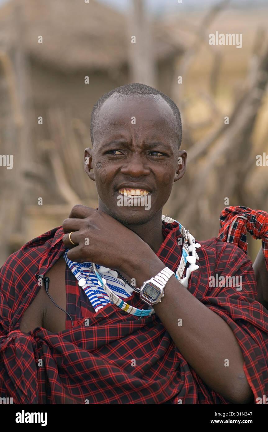 Maasai sceptically watching a traditional gathering, Tanzania - Stock Image