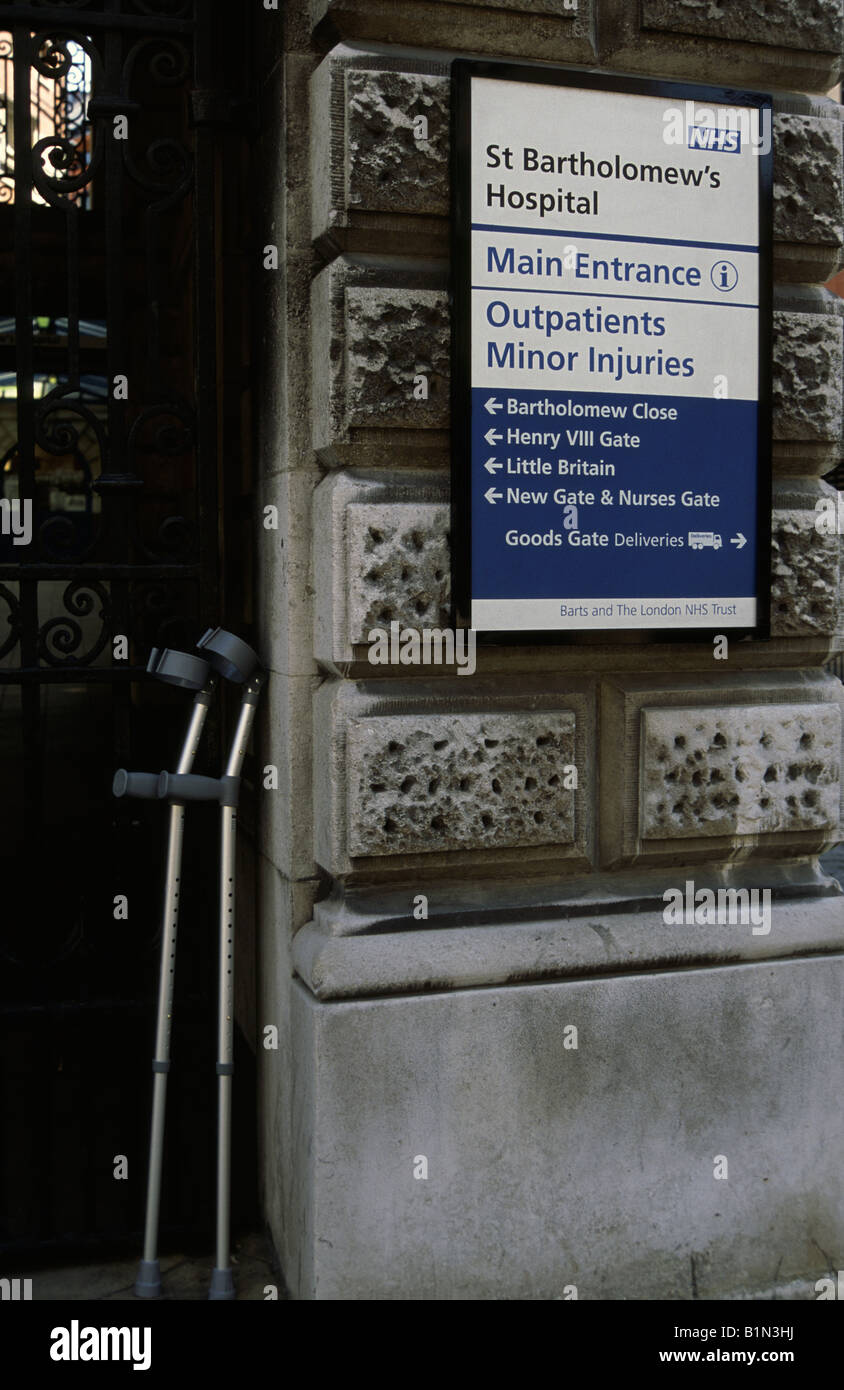 Crutches leaning against the entrance to St Barts (St Bartholomews) Hospital Outpatient department London UK - Stock Image