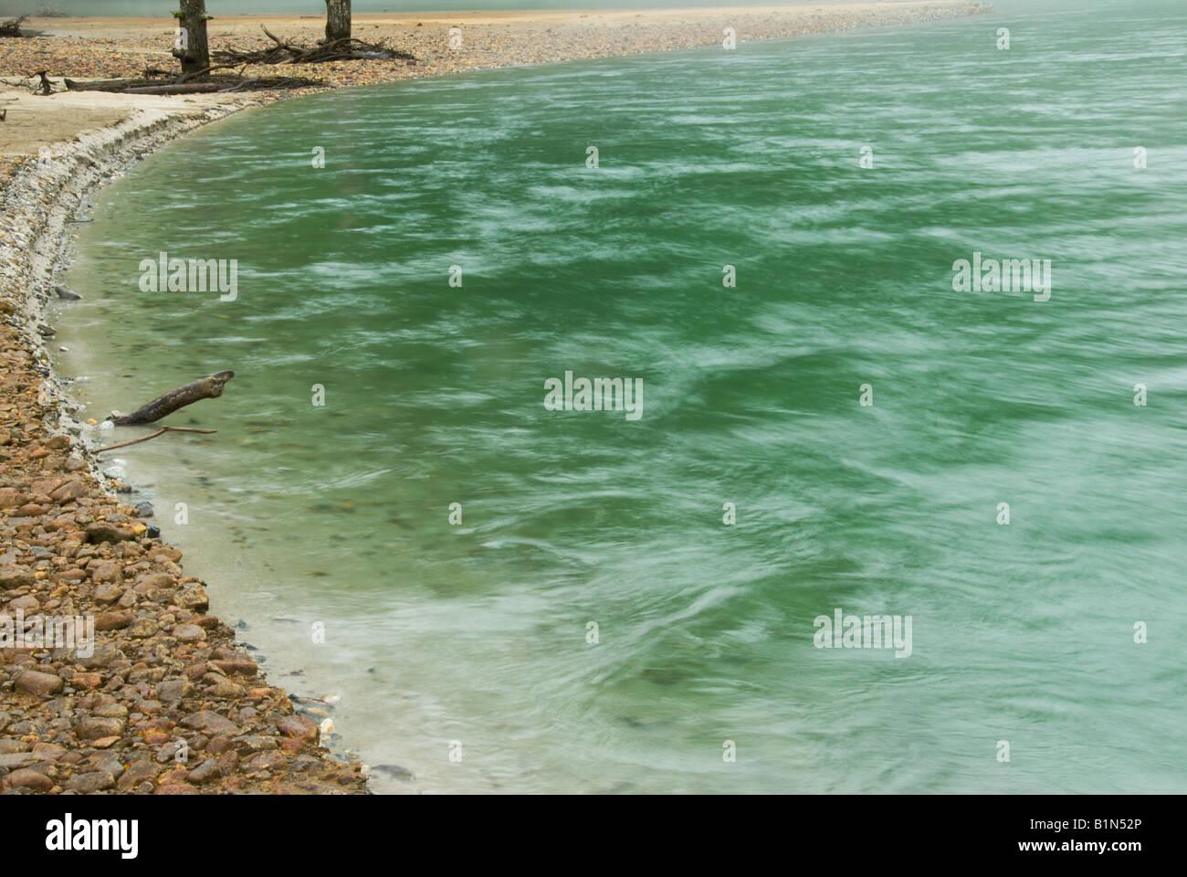 Water flowing at Taisho Ike Pond at Kamikochi. Taisho-Ike was formed when neighbouring Mount Yake (Yakedake) erupted - Stock Image