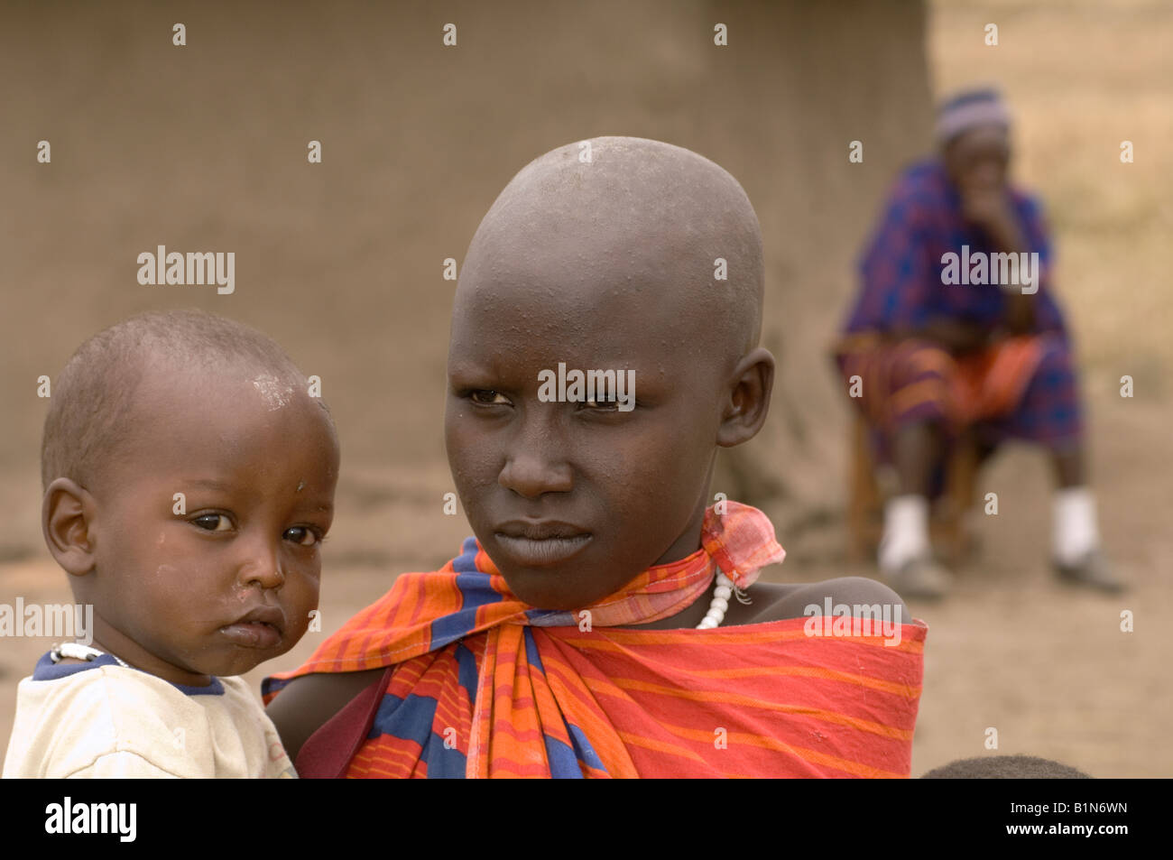 Maasai girl carrying her little sibling, Tanzania - Stock Image