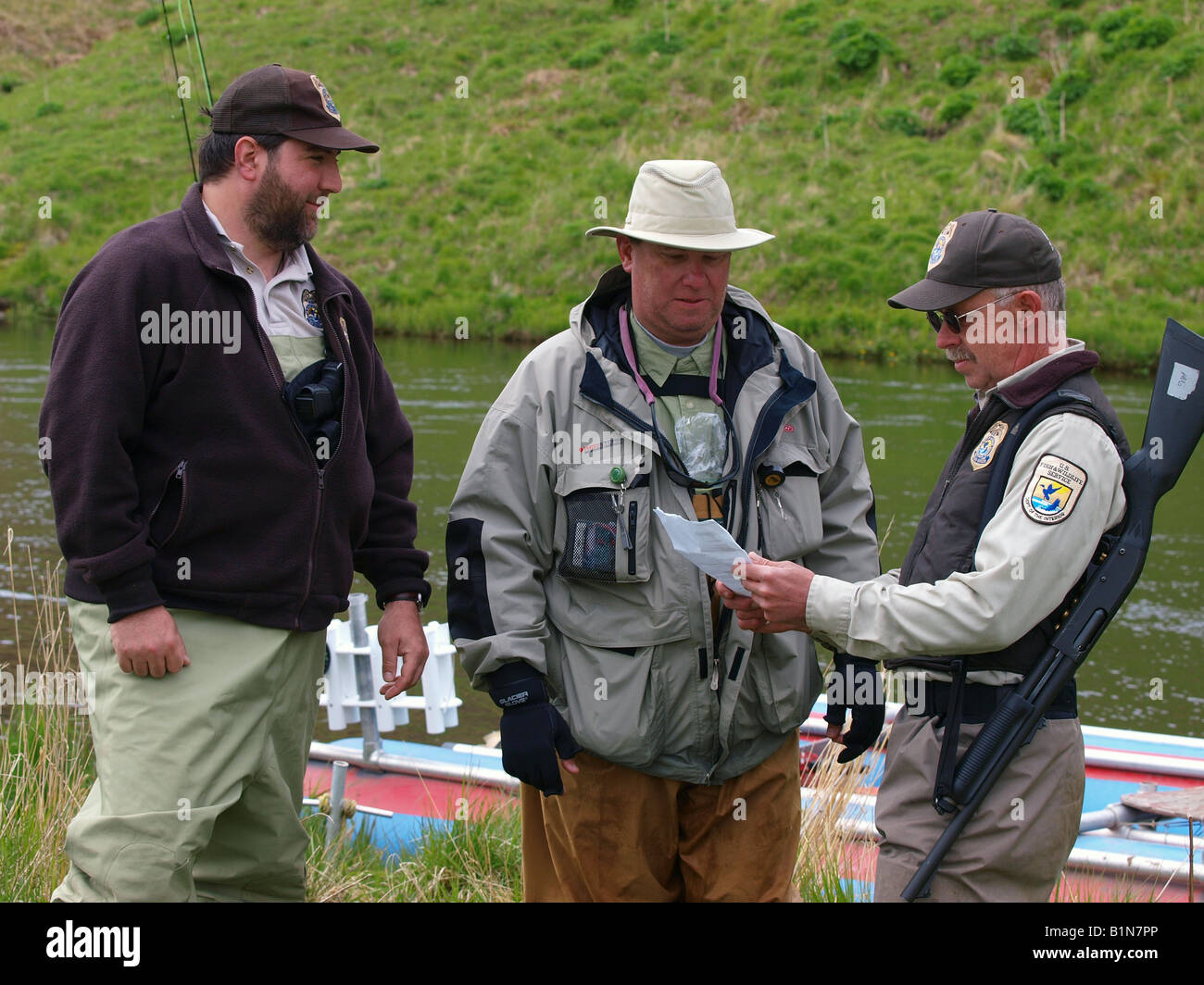 US federal fish and wildlife officers check fisherman's fishing
