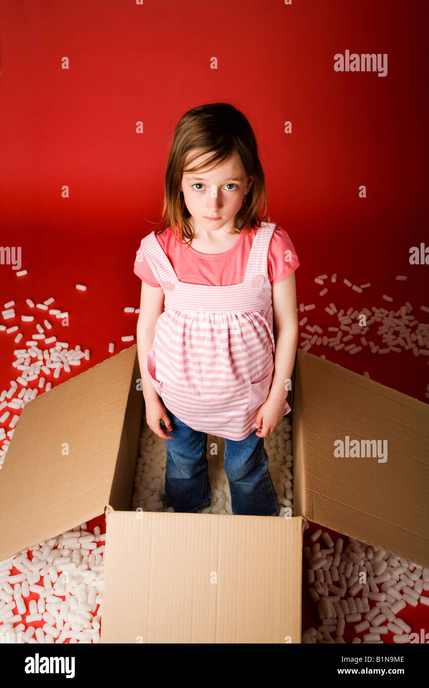 Young girl just been told off for making a mess - Stock Image