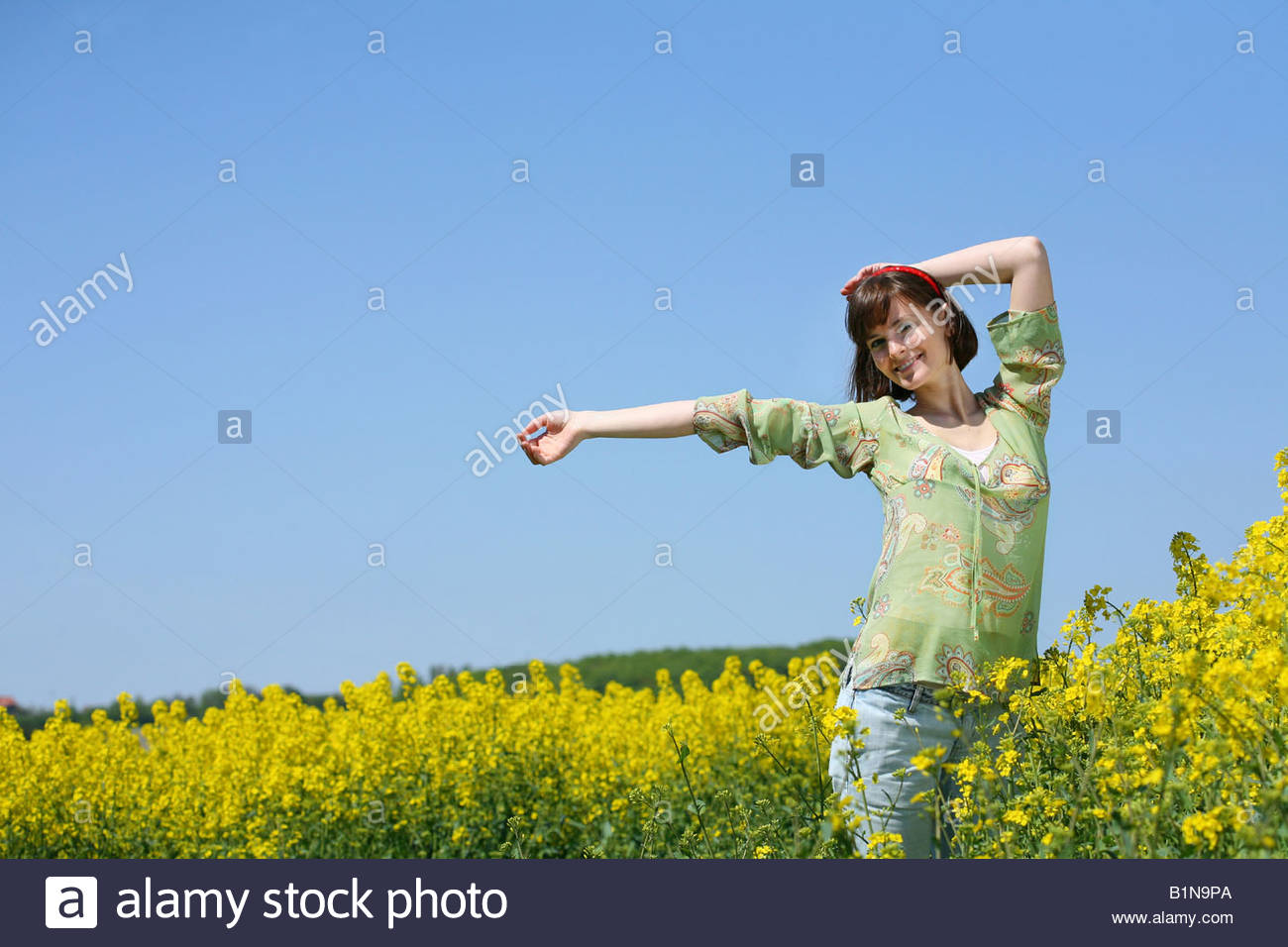 woman sprawled out her arms - Stock Image