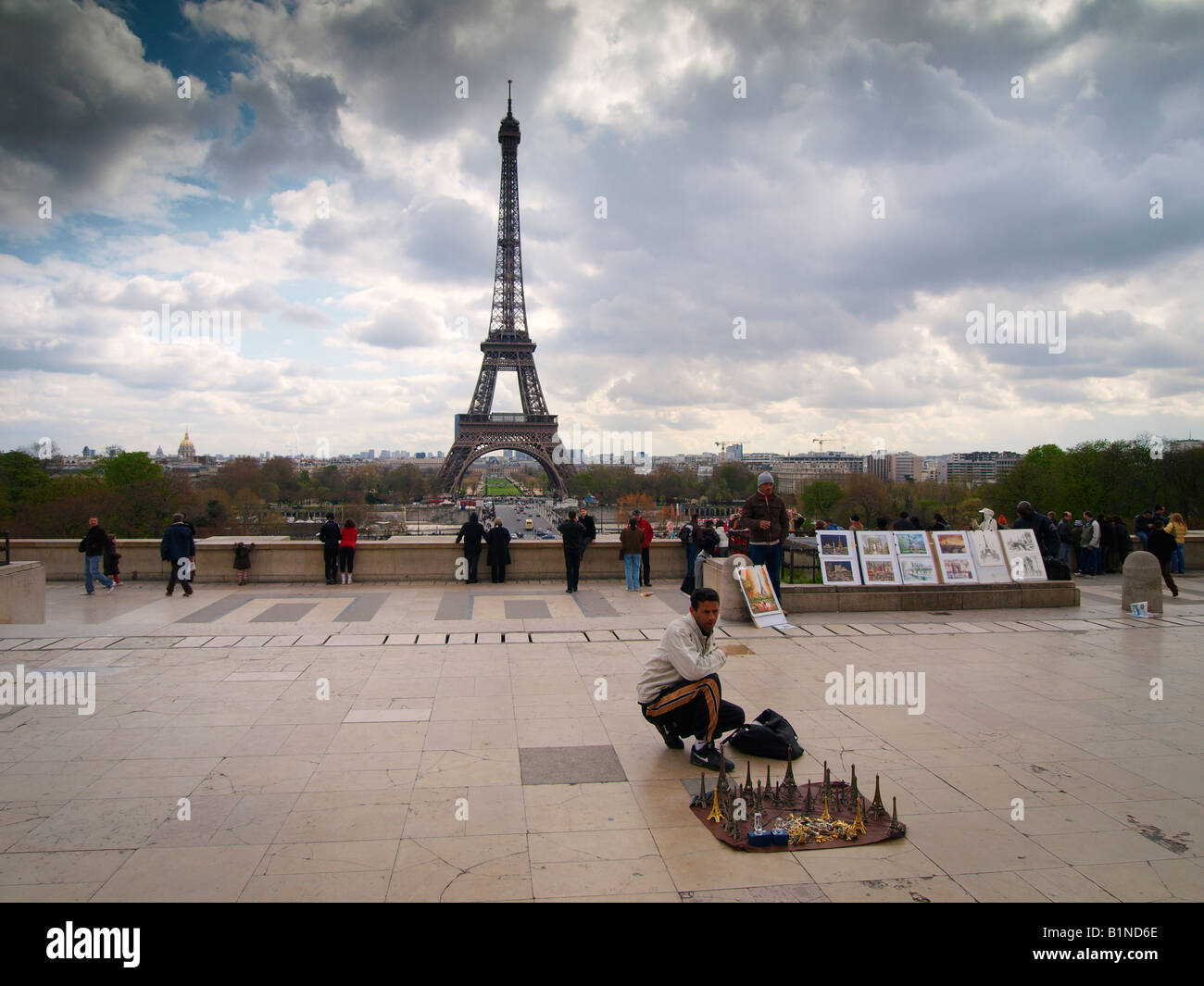 Man selling little Eiffel towers as souvenirs Trocadero Paris France - Stock Image